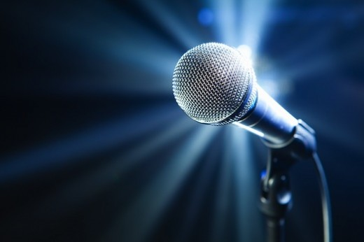 bigstock-microphone-on-stage-with-blue-26918891-520x346